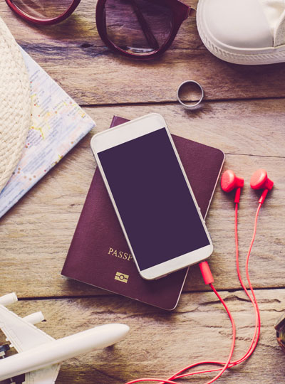 A phone and travel essentials for Business customers on a table.